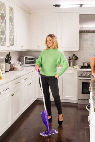 Actress and comedian Abby Elliott smiles as she conquers #adulting with her Swiffer WetJet while filming the Art of Adulting video series with Swiffer in Los Angeles in November. (Photo by Roman Cho/Invision for Swiffer/AP Images)