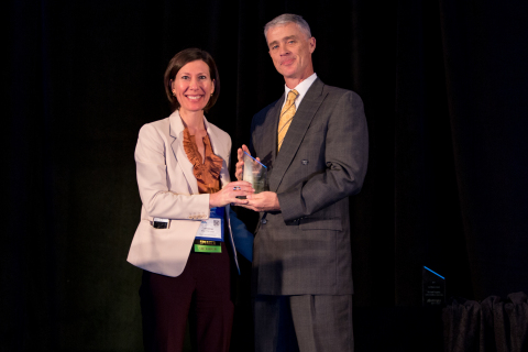 Catherine Macpherson, a registered dietitian and chief nutrition officer at Mom's Meals NourishCare, accepts the Isadore King Service Award at MHPA Annual Conference. (Photo: Business Wire)