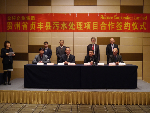 Front, left to right: Mr. Hongfang Xie, General Manager of Jinzi Enterprise Group, Mr. Xiaodong Xie, ...