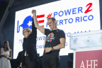AIDS Healthcare Foundation President Michael Weinstein (right) salutes the heroic leadership of San Juan, Puerto Rico Mayor Carmen Yulin Cruz (left) at AIDS Healthcare Foundations (AHF) 30th Anniversary Celebration and World AIDS Day concert that featured Becky G., Yandel and Sheila E., at The Bayfront Park Amphitheater on Friday, Dec. 1, 2017, in Miami, that also raised funds to continue to support relief efforts in Puerto Rico. (Photo by Jesus Aranguren/Invision for AIDS Healthcare Foundation/AP Images)