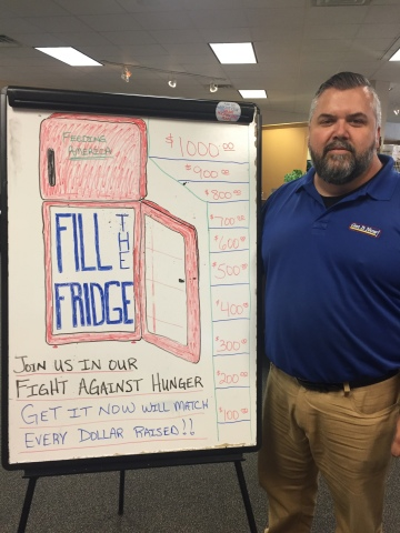 Get It Now coworker gets ready to take donations for Fill the Fridge. (Photo: Business Wire)