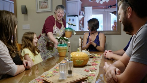 A joyful Dottie Flaherty serves her famous (and delicious) cake pops to family. Baking treats for ot ...