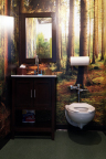 "Charmin Restrooms ""Dropping Logs Stall"" (Photo: Business Wire)"