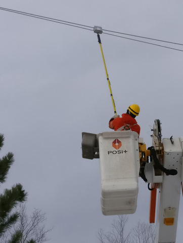 Manitoba Hydro line crew installing Sentient Energy's new ZM1 low amp monitor. (Photo: Business Wire ...