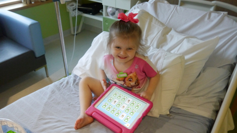 Alder Hey patient Miley enjoying the Alder Play app (Photo: Busines Wire)