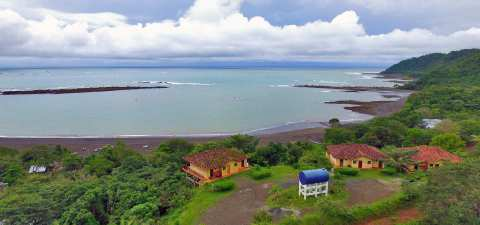 The 411 Surf Spot property is a one hectare (2.47 acres) estate with an ocean view of a famous surf  ...