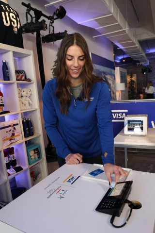Team Visa athlete Hilary Knight purchases Team USA Olympic merchandise at Visa's Winter Olympics Inn ...