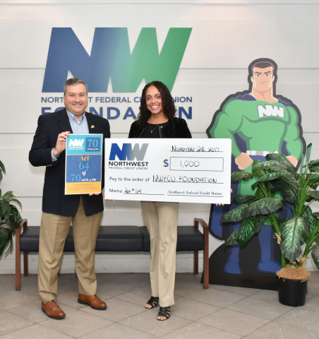 Northwest Federal's President and CEO, Jeff Bentley presents a check to the NWFCU Foundation's Executive Director, Alexandra Shade to jumpstart #GivingTuesday (Photo: Business Wire)