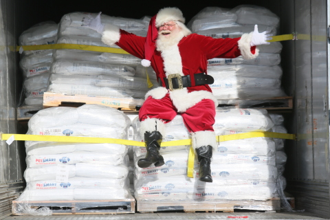 Santa sits atop a truckload of 50 pallets of pet food – 20 tons – donated recently through PetSmart's Buy a Bag, Give a Meal™ program to PAWS San Diego, a pet food pantry program of San Diego Humane Society. PetSmart proudly announced today it has met its goal of generating 60 million meals – 6,384 tons – of pet food to help feed hungry pets in need across the U.S. and Canada through its historic Buy a Bag, Give a Meal program, where for every bag of dog or cat food purchased online or in its 1,600 stores through Dec. 31, 2017, the retailer will donate a meal to a pet in need. To date, PetSmart and PetSmart Charities, the program's pet food distribution partner, have delivered more than 35 million meals – 3,684 tons of pet food – via 188 semi trucks to pets in need across the U.S. and Canada including this recent special delivery with Santa. (Photo: Business Wire)