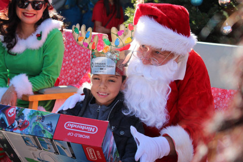 """More than 2,000 underserved children received holiday cheer and presents from Santa Claus at the Orthopaedic Institute for Children's 26th annual """"Toys and Joy"""" celebration in Los Angeles.  Through the years this annual event has brought holiday joy to more than 25,000 families throughout the community. (Photo: Business Wire)"""