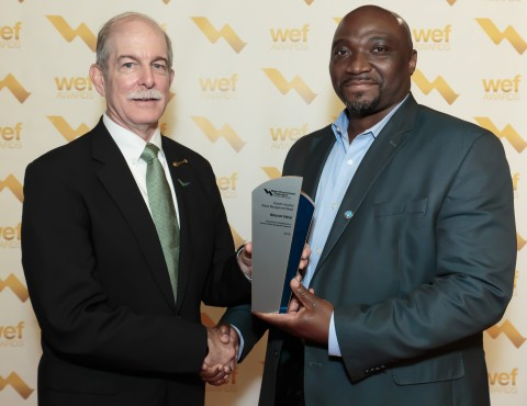 Dr. Fabiyi (right) receiving the Rudolfs Industrial Waste Management Medal from WEF in 2016. The award recognizes accomplishments in industrial waste management research. (Photo: Business Wire)