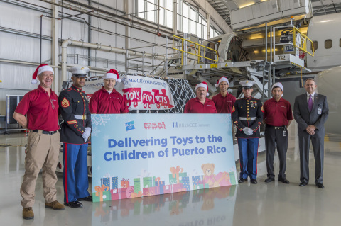 The U.S. Marine Corps Reserve Toys for Tots Program, Hasbro, Inc., Signature Flight Support, and Hillwood Airways, a Perot company and private charter airline, are collaborating to deliver 30,000 toys and games to families in need in Puerto Rico, just in time for the holidays. Credit: Debra Hale, Hillwood.