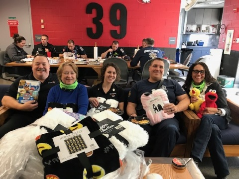 First responders at #39 North Point Station in Reston, Va. with Mission BBQ's Community Ambassador, Liz McGuirk (center), and Executive Director of the NWFCU Foundation, Alexzandra Shade (right) (Photo: Business Wire)