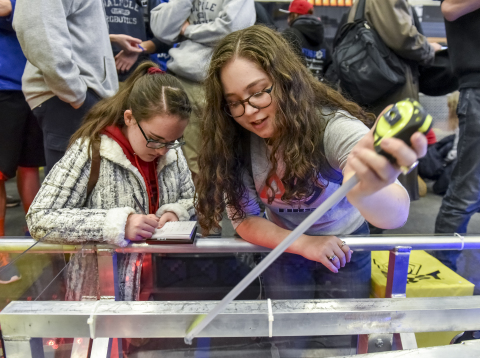 FIRST® Robotics Competition student participants measure the field for the 2018 season game, FIRST®  ...