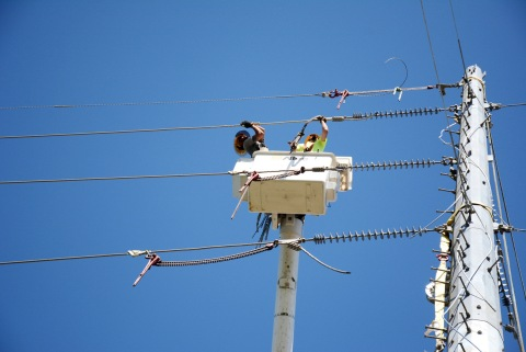 A Fluor subcontractor works to complete transmission lines in Puerto Rico. (Photo: Business Wire)
