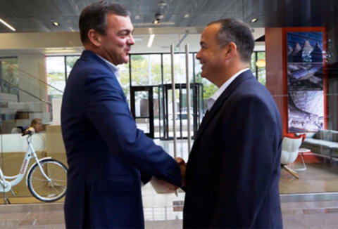 John Ferrara, Former Founder and President of Capstone Partners and CEO of Capstone Headwaters, and Phil Seefried, Former Founder and CEO of Headwaters MB and President of Capstone Headwaters, shake hands in Capstone Headwaters Denver Headquarters. (Photo: Business Wire)