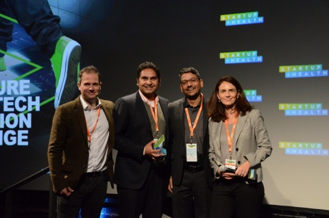 Pictured are Jvion executives accepting the designation of Top Innovator by John Pugh of Accenture at the 2018 Accenture HealthTech Innovation Challenge (Photo: Business Wire)