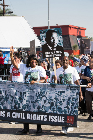 "AHF's marchers and activists promote ""AIDS Is A Civil Rights Issue"" at the 2015 Kingdom Day Parade i ..."