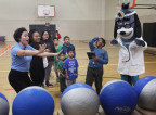 "UnitedHealthcare donated 200 NERF Energy Game Kits to the YMCA of Superior California as part of a national initiative to encourage young people to become more active through ""exergaming."" UnitedHealthcare's Nicole Borreli (light blue shirt) and mascot Dr. Health E. Hound cheer for Syeed Williams, 9, of Sacramento as he plays the NERF ENERGY Rush game. The donation is part of a recently launched national initiative between Hasbro and UnitedHealthcare, featuring Hasbro's NERF products, that encourages young people to become more active through ""exergaming"" (Photo: Gary Fong)."