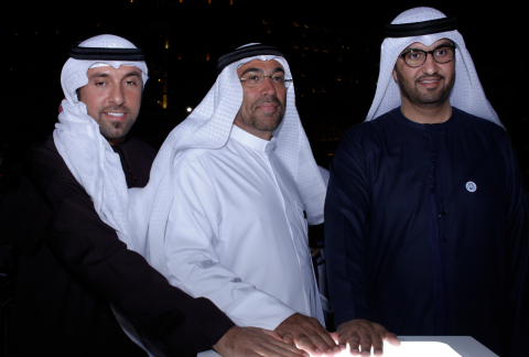 HE Dr. Mohammed Ateeq Al Falahi - Secretary General, Emirates Red Crescent, HE Ahmed Al Sayegh - Chairman Abu Dhabi Global Market and HE Dr. Sultan Al Jaber - Minister of State and Director-General of the Zayed Future Energy Prize light up the installation. (Photo: AETOSWire)