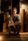 Luthier Reuben Forsland with wood from Jimi Hendrix's house (Photo: Business Wire)