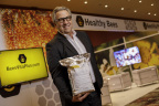 Lee Rosen, Chairman & CEO, Healthy Bees, LLC, holding 5K Package of BeesVita Plus, Revolutionary Honeybee Varroa Mite Controller & Dietary Supplement at American Beekeeping Federation Conference, Reno, Nev. (Photo: World Satellite Television News)