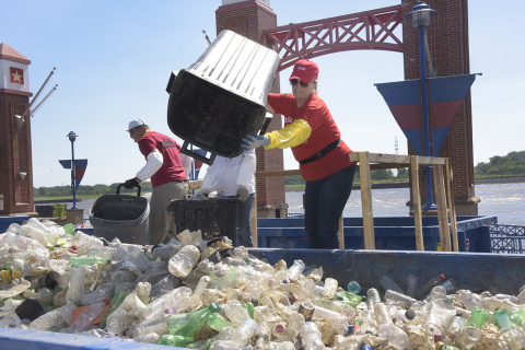 In 2017, employees from Heartland Coca-Cola Bottling Co. joined with other volunteers in St. Louis to collect and sort 14,480 pounds of debris; 63 percent was diverted for recycling. Coca-Cola then partnered with manufacturer Phoenix Technologies to convert plastic bottles into recycled PET plastic for use in new bottles. (Photo: Business Wire)