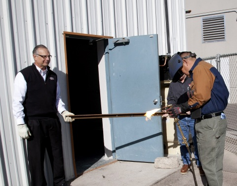 """On January 17th, Lincoln Electric's Jerry Siko and RSI Lead Instructor Larrison Smith raise the bar in a ceremonial """"ribbon cutting"""" to celebrate the grand opening of the new Welding Specialist Program at the Phoenix campus. (Photo: Business Wire)"""