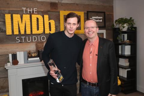 "Bill Skarsgård receives the IMDb ""Fan Favorite"" STARmeter Award from Col Needham, Founder and CEO of IMDb, in The IMDb Studio at the 2018 Sundance Film Festival. (Photo: Business Wire)"