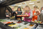 Students at Saint Ambrose Catholic School line-up to use a new salad bar, donated by Dole Food Company and Marc's Stores to encourage healthier food options. (Photo: Business Wire)