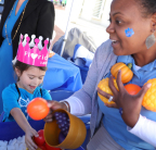 Kimberly Haynes of UnitedHealthcare demonstrates healthy food choices with Lilia Vail, 6, during Children's Week at the Florida Capitol Tuesday, Jan. 23, 2018. UnitedHealthcare is awarding $150,000 in grants to five partner organizations around the state to fight hunger and help make families more food secure (Photo: Lily Chanta).
