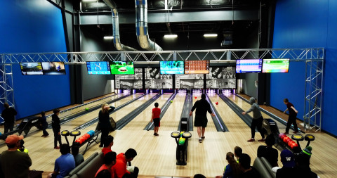 Throwing strikes in the alleys at Arena Sports Mill Creek (Photo: Business Wire)