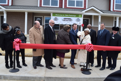Community leaders, project partners, housing advocates and residents celebrate the grand opening of New Parkridge, a new affordable-housing community in Ypsilanti. L-R: Resident Janea Davis and daughter Martasia D. (11); James M. Smith, President, Eastern Michigan University; Jim Logue, COO, Cinnaire; Reneé Smith, chair, Ypsilanti Housing Commission; Zachary Fosler, executive director, Ypsilanti Housing Commission; Beverly Washington James and son Raphael Washington; Dennis Moura, CEO, UnitedHealthcare Community Plan of Michigan; Earl Poleski, executive director, MSDHA (Photo: Nick Azzaro).