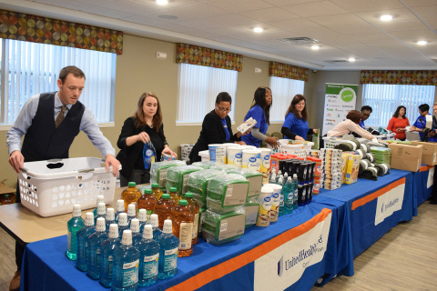 """UnitedHealthcare employees and volunteers assemble """"welcome baskets"""" to be donated to newly-moved in residents of New Parkridge, a new affordable-housing community in Ypsilanti. UnitedHealthcare is the largest investor in New Parkridge, providing $8 million to help build the new community (Photo: Nick Azzaro)."""