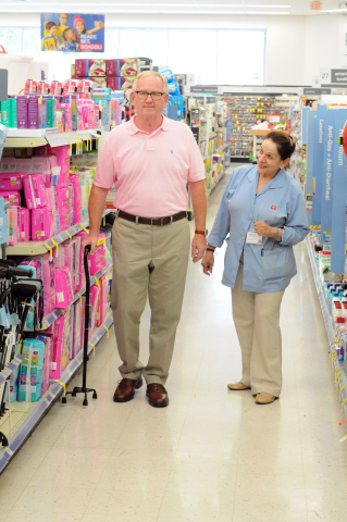 Store employee Malvina Garcia Kasperavicius (right) checks a customer's fit and height adjustment for a quad cane at the Walgreens store in Western Springs, Ill., July 11, 2017. (Photo: Business Wire)