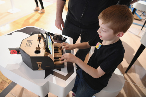 In this photo provided by Nintendo of America, kids enjoy playing tunes on a Toy-Con Piano at an exclusive event in New York on Feb. 2, 2018. Toy-Con Piano is one of five different Toy-Con projects included in the Nintendo Labo Variety Kit, launching in stores on April 20. Nintendo Labo kits offer interactive build-and-play experiences designed to inspire creativity and discovery.