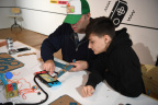 In this photo provided by Nintendo of America, kids enjoy making a Toy-Con Fishing Rod at an exclusive event in New York on Feb. 2, 2018. Toy-Con Fishing Rod is one of five different Toy-Con projects included in the Nintendo Labo Variety Kit, launching in stores on April 20. Nintendo Labo kits offer interactive build-and-play experiences designed to inspire creativity and discovery.