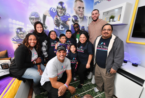 """Comedian Kevin Hart and Vikings safety Harrison Smith surprise Minnesota boy battling leukemia at the unveiling of his football-themed """"Imagine Me"""" bedroom makeover made possible by BrittiCares and Rally Health on Feb 3. Here, Kevin Hart, Harrison Smith, Rally Health SVP Brenda Yang, BrittiCares Founders Shirell and Jamie Henderson, and Andrew and the Rojas Family pose for the camera. Photo credit: Getty Images."""