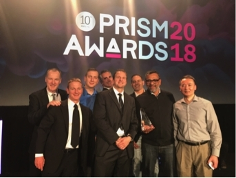 SLD Laser team accepts the 2018 Prism Award for Illumination and Light Sources. (Photo: Business Wir ...