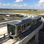 """Mitsubishi Heavy Industries America's """"Crystal Mover"""" APM System Begins Operations at Tampa International Airport"""