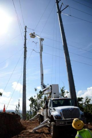 Fluor crews work to repair power lines in Puerto Rico. The company has helped restore power to more than 232,000 customers throughout the island since arriving in October. (Photo: Business Wire)