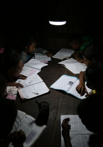 Solar lanterns are also used for supplementary nighttime studying by children. (Photo: Business Wire)