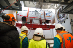 The accelerator module enters the treatment vault and will be readied to mount onto the rotating gantry arms. (Photo: Business Wire)