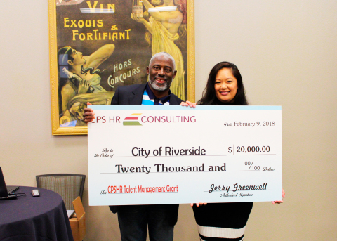 Jerry Greenwell, CPS HR Consulting CEO, awards Stephanie Holloman, City of Riverside human resources ...