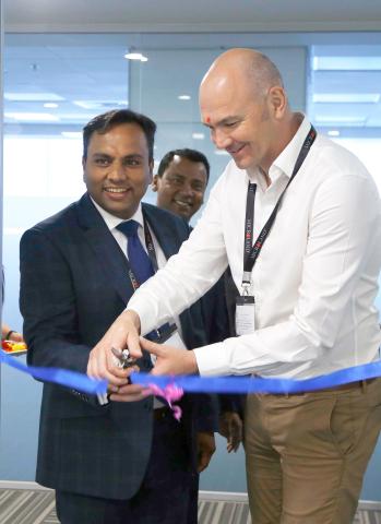 Sachin Verma, Managing Director, Oreta (left) inaugurates the Microland Oreta Digital Operations Cen ...