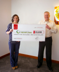 On Thursday, Schwan's Vice President of operations and Logistics, Joe Kirby, presented Second Harvest Heartland's Corporate Partnerships Office, Amanda Pieper with a donation check for $25,000. (Photo: Schwan's Home Service, Inc.)