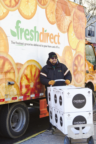 FreshDirect driver Raymond Talovera delivers donated Chobani yogurt to CS 300 in the South Bronx on Valentine's Day. (Photo Credit: Joy Kim for FreshDirect)