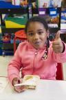 CS 300 student enjoys her Chobani yogurt snack. (Photo Credit: Joy Kim for FreshDirect)
