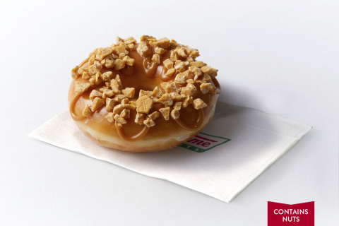 The Hershey's Gold Doughnut is a delicious pairing of Krispy Kreme's iconic Original Glazed Doughnut, topped with pieces of the new Hershey's Gold bar and a salted caramel icing. This product does contain nuts. (Photo: Business Wire)