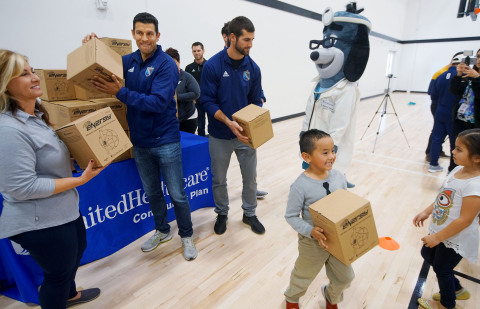 """UnitedHealthcare donated 150 NERF ENERGY Game Kits to the Jackie Robinson Family YMCA as part of a national initiative to encourage young people to become more active through """"exergaming."""" Monique Knight, UnitedHealthcare Community Plan of California, and San Diego Sockers Anthony Medina, forward, and Luan Oliveira, midfielder, distributed kits to the members earlier today. The donation is part of a national initiative between Hasbro and UnitedHealthcare, featuring Hasbro's NERF products, that encourages young people to become more active through """"exergaming."""" (Photo: Sandy Huffaker)."""
